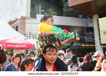BANGKOK, THAILAND - 13 April 2017 :Play with water gun water gun was the splashing water on each other in Songkran Water Festival at Siam Square.