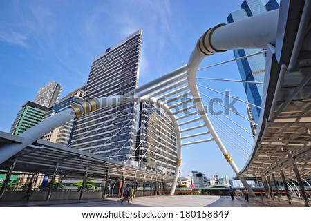 BANGKOK, THAILAND-APRIL 28: Public skywalk with modern buildings of Bangkok downtown square in business zone on April 28, 2011 in Bangkok , Thailand.