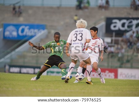 BANGKOK, THAILAND - APRIL 24: R.Santana (green) in action during Thai Premier League (TPL) between Army Utd. (green) vs Insee Police Utd. (white) on April 24, 2011 at Army Stadium in Bangkok Thailand
