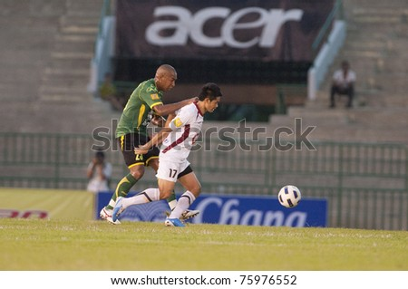 BANGKOK, THAILAND - APRIL 24: T.Pinho (green) in action during Thai Premier League (TPL) between Army Utd. (green) vs Insee Police Utd. (white) on April 24, 2011 at Army Stadium in Bangkok Thailand