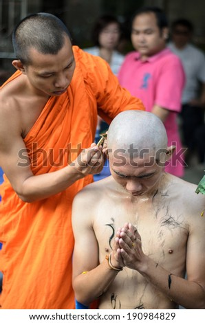 BANGKOK,THAILAND - APRIL 27 : Thai man during a Buddhist ordination ceremony during which he becomes a monk. Monk shaved his hair and eyebrow on April 27,2014 in Bangkok,Thailand - stock photo