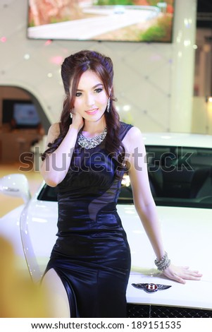 BANGKOK, THAILAND - APRIL 6, 2014: Unidentified model with Bentley in the 35th Bangkok International Motor Show on April 6, 2014 in Bangkok, Thailand.