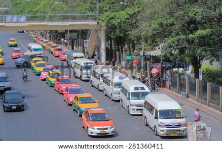 BANGKOK THAILAND - APRIL 19, 2015: Unidentified people catch buses and taxies in Bangkok. Bangkok is famous for its heavy traffic congestion.  - stock photo