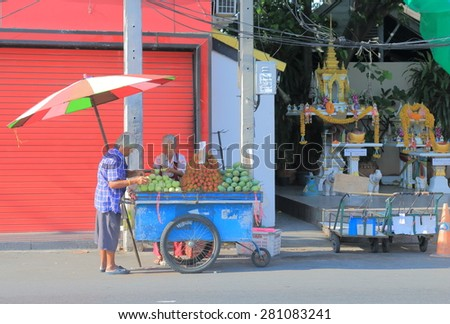 BANGKOK THAILAND - APRIL 19, 2015: Unidentified people sells fruits on street. Many people sells various products on streets in Thailand.  - stock photo