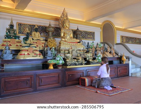 BANGKOK THAILAND - APRIL 21, 2015:Unidentified woman prays at Wat Saket. Wat Saket is a Buddhist temple which dates back to the Ayutthaya era.