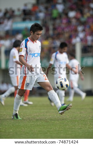 BANGKOK THAILAND- APRIL 6: V.nuntasri (White) in Thai Premier League (TPL) game between thai port fc (Orange) vs TOT SC (green) on April 6, 2011 at PAT Stadium in Bangkok Thailand