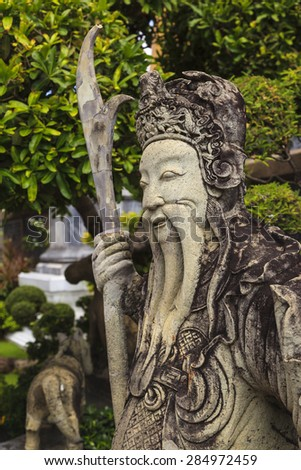 BANGKOK  THAILAND - APRL 22 2014 : Guardsman -  big stone statue in Wat Pho Temple,Wat Pho is a Buddhist temple in Phra Nakhon district. Thailand is rich in ancient culture and art.  - stock photo