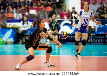 BANGKOK,THAILAND-AU GUST15:Piyanut	 Pannoy of Thailand receives the ball during the FIVB World Grand Prix Thailand and Dominican Republic at Indoor Stadium Huamark on Aug.15, 2014 in Thailand.