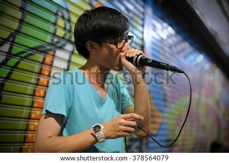 BANGKOK, THAILAND - AUG 23, 2012: A man beatboxes on a city centre street. Hip hop culture and beatboxing has an underground following among Thai youth. - stock photo