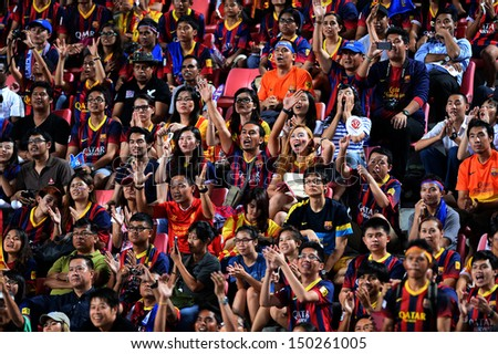 BANGKOK,THAILAND-Aug 7:Barcelona fans cheer during the friendly match between FC Barcelona and Thailand national team at Rajamangala stadium on Aug 7,2013 in,Thailand