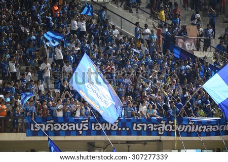 BANGKOK THAILAND- AUG 16: Chonburi FC fans cheering during the competition Thai Premier League 2015 between BEC and Chonburi FC at Minburi Stadium on August 16, 2015 in Bangkok, Thailand. - stock photo