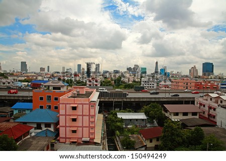 BANGKOK, THAILAND-AUG 10: cityscape view of houses, buildings, and Bangkok express way against sky cloud on August 10, 2013 in Bangkok, Thailand.