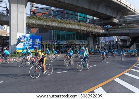 """BANGKOK,THAILAND, AUG 16-2015 : Cyclists riding through Victory Monument in """"Bike for Mom"""" event. These event show respected to Queen and set new Guinness World record. - stock photo"""