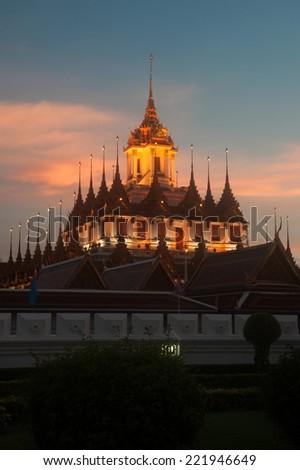 BANGKOK,THAILAND-AUG 17 : Scenic of twilight at Wat Rat Natda Ram Worawihan Monastery or Loha Prasat Metal Palace is important Buddhist Temple on August 17,2014 in Bangkok capital city of Thailand. - stock photo