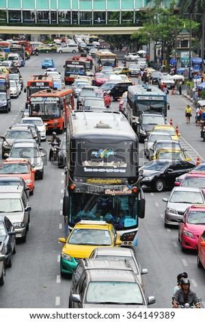 BANGKOK, THAILAND - AUG 18, 2013: Traffic reaches grid lock on a busy city centre road. Each year an estimated 150,000 cars join the heavily congested roads of the Thai capital.