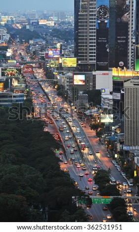 BANGKOK, THAILAND - AUG 4, 2013: View of a busy road cutting through the Thai capital's modern skyline. The south east Asian city is developing rapidly with an economy worth 29% of the country's GDP. - stock photo