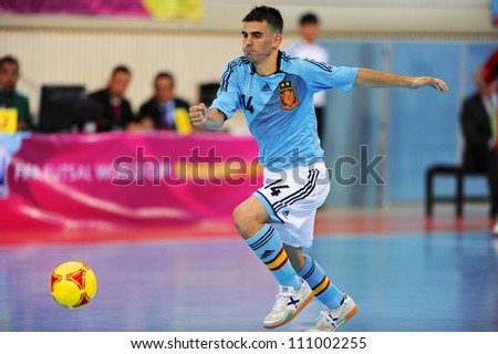 BANGKOK,THAILAND AUGUST24:Alex Yepes (blue) of Spain for the ball during Friendly match between Thailand and Spain at Nimibutr Stadium on August24,2012 in Bangkok Thailand