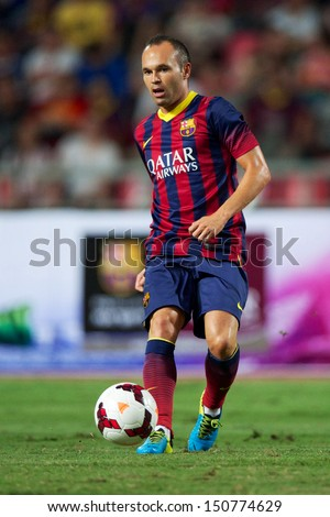 BANGKOK,THAILAND-AUGUST07:Andres Iniesta of FC Barcelona in action during the international friendly match Thailand XI and FC Barcelona at Rajamangala Stadium on August 7,2013 in,Thailand. - stock photo