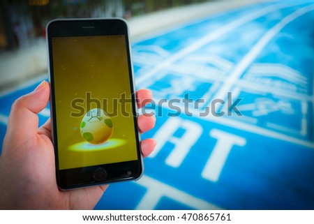 BANGKOK, THAILAND - August 12,2016:Apple iPhone6s held in one hand showing its screen Are hatched with Pokemon Go application.