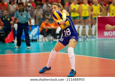 BANGKOK,THAILAND-AUGUST15:Bailey	Websterof USA receives the ball  during the FIVB Women's World Grand Prix 2014  Brazil and USA at Indoor Stadium Huamark on Aug.15, 2014 in Thailand.