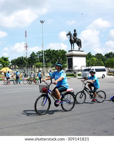 BANGKOK/ THAILAND-AUGUST 16: Bike for Mom activity in Thailand, Guinness Book of world records on August 16, 2015 in Bangkok. A boy rides bicycle follow his mother. - stock photo