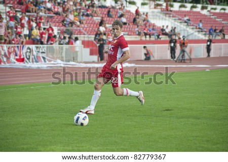 BANGKOK THAILAND - AUGUST 13 : C.Prandon (red) in action during Toyota League Cup between BEC Tero Fc (R) vs SCG Samutsongkhram Fc (W) on August 13 , 2011 at the bhussadin Stadium Bangkok, Thailand - stock photo