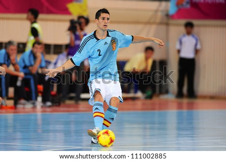 BANGKOK,THAILAND AUGUST24:Carlos Ortiz (blue no.2) of Spain for the ball during Friendly match between Thailand and Spain at Nimibutr Stadium on August24,2012 in Bangkok Thailand