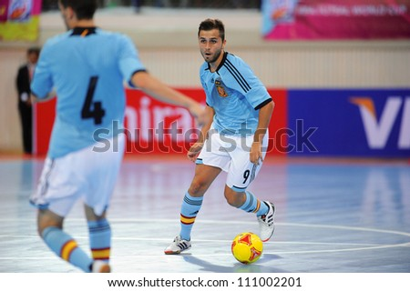 BANGKOK,THAILAND AUGUST24:Carlos Ortiz (blue) of Spain in action during Friendly match between Thailand and Spain at Nimibutr Stadium on August24,2012 in Bangkok Thailand