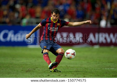 BANGKOK,THAILAND-AUGUST 07:Cesc Fabregas of FC Barcelona shoots the ball during the international friendly match Thailand XI and FC Barcelona at Rajamangala Stadium on August 7,2013 in,Thailand.