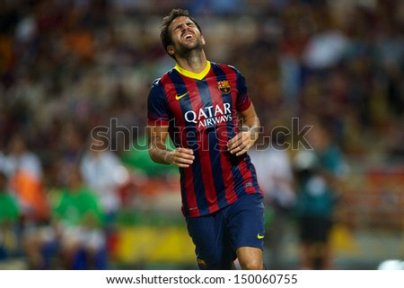 BANGKOK,THAILAND-AUGUST07:Cese Fabregas of Barcelona reacts after missing a shot  the international friendly match Thailand XI and FC Barcelona at Rajamangala Stadium on August 7,2013 in,Thailand. - stock photo