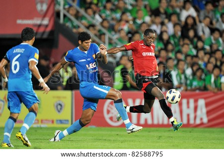 BANGKOK THAILAND- AUGUST 10:Christian Kouakou Yao of MTUTD  in Thai Premier League (TPL) between Muangthong United and Bangkok Glass FC at Yamaha Stadium on August 10,2011 in Bangkok Thailand
