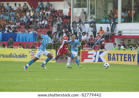 BANGKOK THAILAND - AUGUST 13 : G.Koomson (red) in action during Toyota League Cup between BEC Tero Fc (R) vs SCG Samutsongkhram Fc (W) on August 13 , 2011 at the bhussadin Stadium Bangkok, Thailand