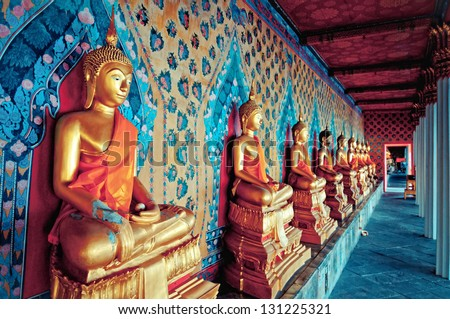 BANGKOK, THAILAND - AUGUST 11: golden Buddha statues in Wat Arun temple, Bangkok - Thailand on August 11,2012. Buddhism is Thailand official religion and is the religion of more than 90% of its people - stock photo