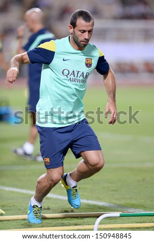 BANGKOK, THAILAND - AUGUST 06: Javier Mascherano of FC Barcelona  in action during FC Barcelona training session at Rajamangala Stadium on August 06, 2013 in Bangkok, Thailand.