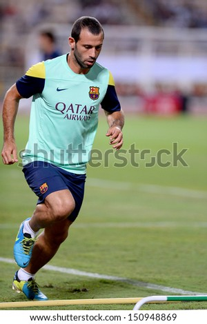 BANGKOK, THAILAND - AUGUST 06: Javier Mascherano of FC Barcelona run during FC Barcelona training session at Rajamangala Stadium on August 06, 2013 in Bangkok, Thailand.