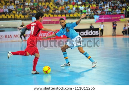 BANGKOK THAILAND - AUGUST 24 : Jesus Aicardo (B) in action during Friendly futsal match Between Thailand VS Spain at Nimibutr Stadium on August 24,2012 in Bangkok,Thailand. - stock photo