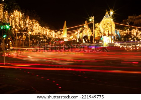 BANGKOK, THAILAND-AUGUST 11 : Light on tree and traffic birthday celebration (Mother day) Queen of Thailand on August 11, 2014 at Ratchadamnoen road in Bangkok capital city of Thailand