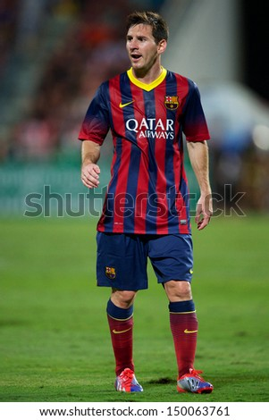 BANGKOK,THAILAND-AUGUST07: Lionel Messi of Barcelona in action during the international friendly match between Thailand XI and FC Barcelona at Rajamangala Stadium on August 7,2013 in,Thailand. - stock photo