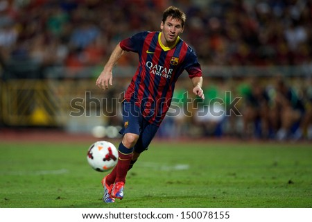 BANGKOK,THAILAND-AUGUST07:Lionel Messi of FC Barcelona run with the ball during the international friendly match  Thailand XI and FC Barcelona at Rajamangala Stadium on August 7,2013 in,Thailand. - stock photo