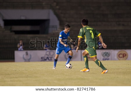 BANGKOK THAILAND- AUGUST 6 : P.Lang in action during Thai Premier League (TPL) between Army Utd. (green) vs Bangkok Glass fc (Blue) on August 6, 2011 at Army Stadium in Bangkok Thailand