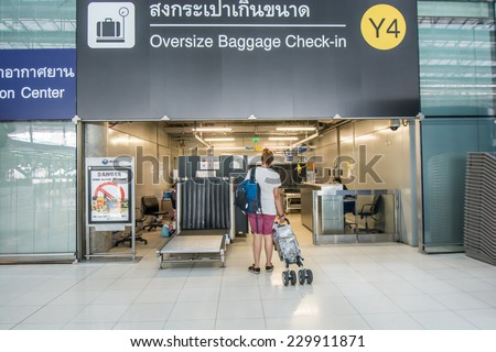 Bangkok,Thailand-August 31,2014 : :Passengers arrive at oversize baggage check in desk  in Suvarnabhumi Airport  in Bangkok ,Thailand.This airport is handling about 45 million passengers annually. - stock photo