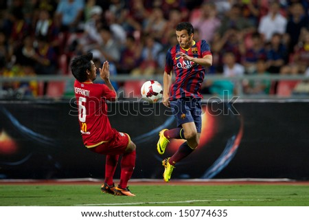 BANGKOK,THAILAND-AUGUST07:Pedro Rodrguez (R) of FC Barcelona in action during the international friendly match Thailand XI and FC Barcelona at Rajamangala Stadium on August 7,2013 in,Thailand. - stock photo