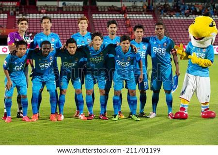 BANGKOK THAILAND-AUGUST 16:Players of Samutsongkhram FC shot photo during  the Thai Premier League between Muangthong UTD. and Samutsongkhram FC at SCG Stadium on Aug 16,2014 in Thailand. - stock photo