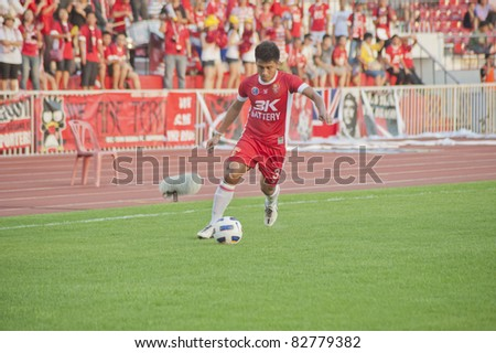 BANGKOK THAILAND - AUGUST 13 :S.Phupa (red) in action during Toyota League Cup between BEC Tero Fc (R) vs SCG Samutsongkhram Fc (W) on August 13 , 2011 at the bhussadin Stadium Bangkok, Thailand - stock photo