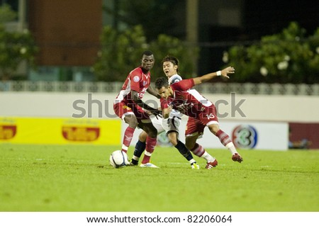 BANGKOK THAILAND - AUGUST 3 : S.Watyuchutikul (White) in action during Toyota League Cup  between BEC Tero Fc (Red) vs Supunburi Fc (White) on August 3 , 2011 at thebhussadin Stadium Bangkok, Thailand