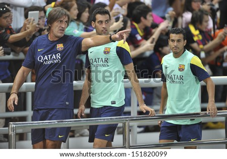 BANGKOK, THAILAND-AUGUST 06:Sergio Busquets(L2) of Barcelona FC in action during Barcelona FC training session at Rajamangala Stadium on August 06, 2013 in Bangkok,Thailand.