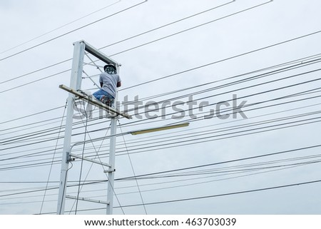 BANGKOK, THAILAND - AUGUST 3, 2016: Technician Climbed to the equipment label after Storm damage,