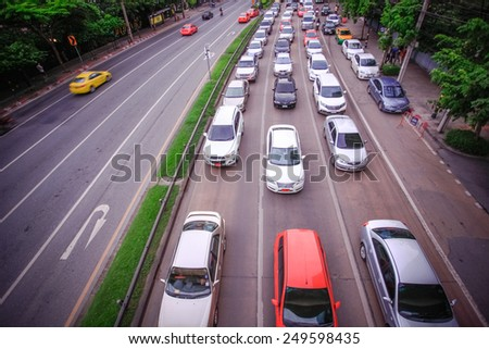 BANGKOK, THAILAND, 4 AUGUST 2014, Traffic on a busy road in the city centre - stock photo