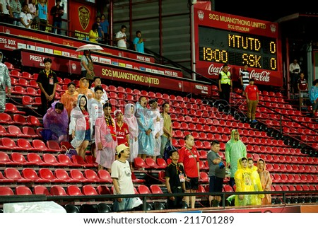 BANGKOK THAILAND-AUGUST 16: Unidentified fan of Muangthong UTD supporters during  the Thai Premier League between Muangthong UTD. and Samutsongkhram FC at SCG Stadium on Aug 16,2014 in Thailand. - stock photo