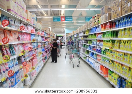 BANGKOK, THAILAND - AUGUST 02, 2014: Unidentified people seeking goods on Aisle at Tesco Lotus supermarket. Tesco is the world's second largest retailer with 6,531 stores worldwide. - stock photo